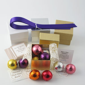 DIY Assorted Foil Favors with purple ribbons, gold & silver linen boxes, assorted flavored foil truffles - corporate party favors