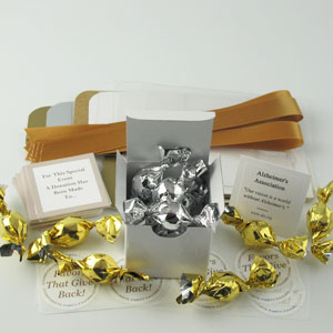 DIY Boxed Mini Favors with gold ribbons, silver and gold mini truffles and charity cards - corporate party favors