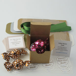 DIY Twist Favors with leaf green ribbons, caramel & raspberry twist truffles, charity cards & favor stickers - corporate party favors