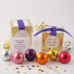 Assorted Foil Favors with purple ribbons on gold linen boxes and assorted foil truffles - corporate party favors