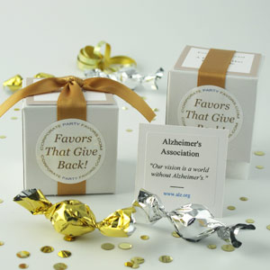 Boxed Mini favors showing gold ribbons on white boxes with silver & gold mini truffles - corporate party favors