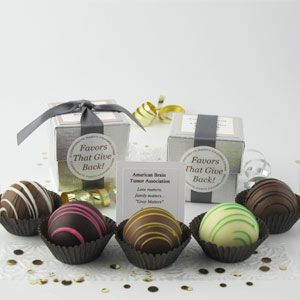 Dessert Favors with pewter ribbons on silver linen boxes and assorted dessert truffles - corporate party favors