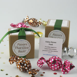 Twist Favors with leaf green ribbons on natural kraft boxes with caramel & raspberry twist truffles - corporate party favors